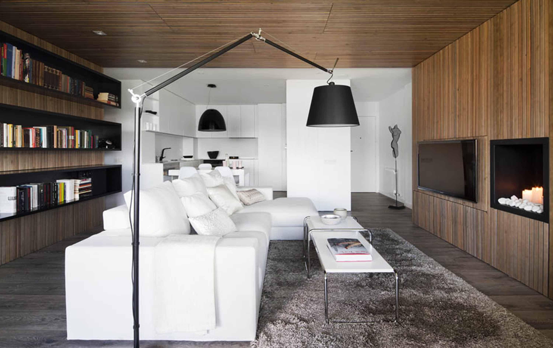 design-modern-apartment-Susanna-Cots-grey-fur-urg-television-white-sofa-cushion-black-floor-lamp-fire-place-bookcase-chandelier